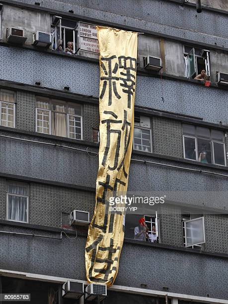 A banner which reads Release Hu Jia is hung down from Hong Kong's infamous guesthouse building Chungking Mansions on Nathan Road in Tsim Sha Tsui as...