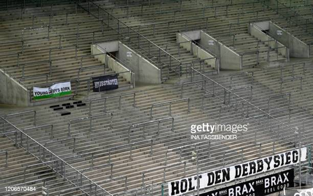 Banner 'win the derby' hangs on the empty tribune during the German first division Bundesliga football match Borussia Moenchengladbach v 1 FC Cologne...