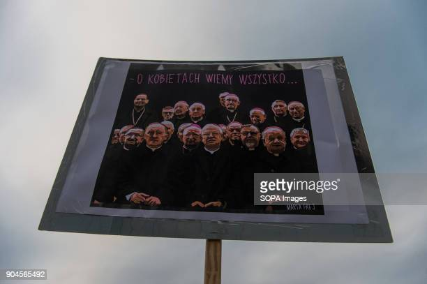 A banner with catholic priests is seen during a protest against the rejected civic proposal of law to liberalize abortion and promote sexual...