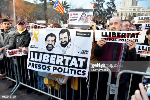 A banner with the face of Jordi Sànchez and Jordi Cuixart seen during the protest Hundreds of people have taken to the streets to demand the freedom...