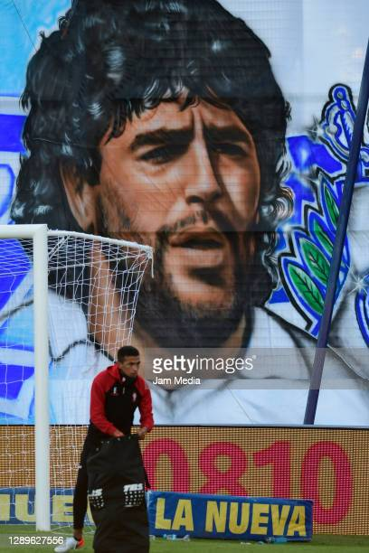Banner with the image of late Diego Maradona is displayed in the stands prior a match between Gimnasia y Esgrima La Plata and Huracan as part of Copa...