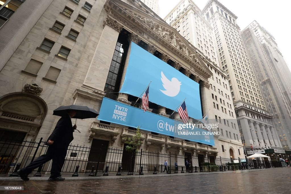 A banner with the logo of Twitter is set on the front of the New York Stock Exchange (NYSE) on November 7, 2013 in New York. Twitter hit Wall Street with a bang on Thursday, as an investor frenzy quickly sent shares surging after the public share offering for the fast-growing social network. In the first exchanges, Twitter vaulted 80.7 percent to $47, a day after the initial public offering (IPO) at $26 per share. While some analysts cautioned about the fast-changing nature of social media, the debut led to a stampede for Twitter shares.