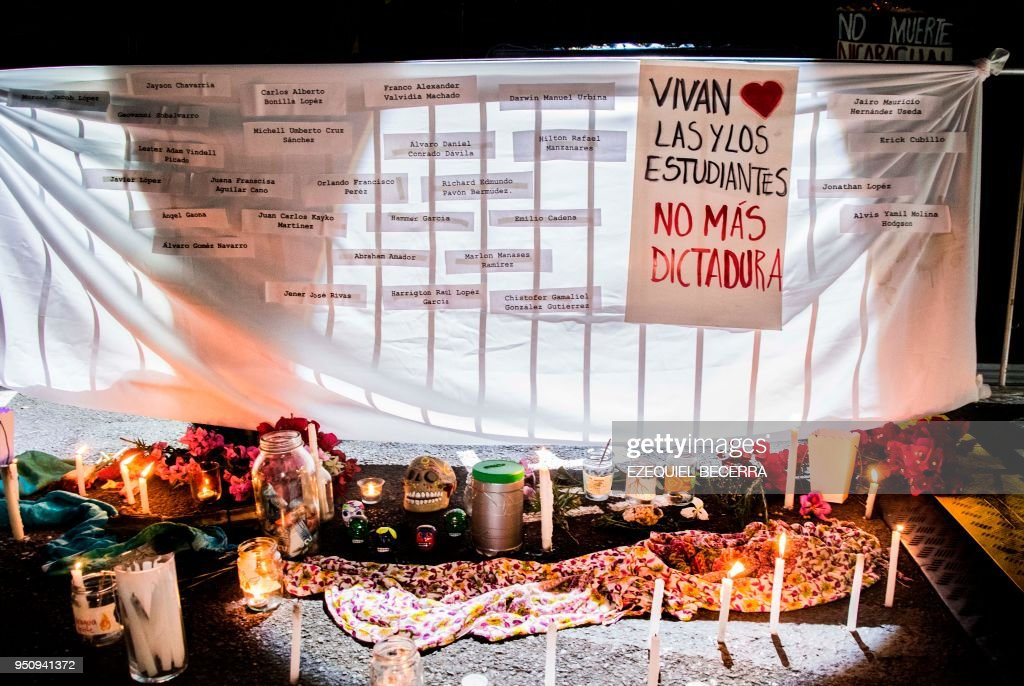 a banner with the names of the university students killed in