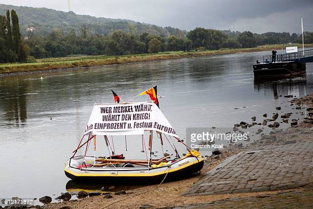 A banner with the slogan 'Wer Merkel waehlt waehlt den Krieg' is fixed on a boat during a ralley of right wing citizens movement 'Festung Europa' on...