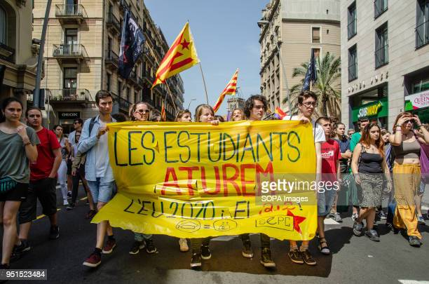 A banner with the text 'students stop' seen during the demonstration Thousands of Catalan university students have demonstrated in the streets of...