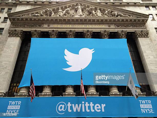 A banner with the Twitter Inc logo hangs outside the New York Stock Exchange in New York US on Thursday Nov 7 2013 Twitter Inc raised $182 billion in...