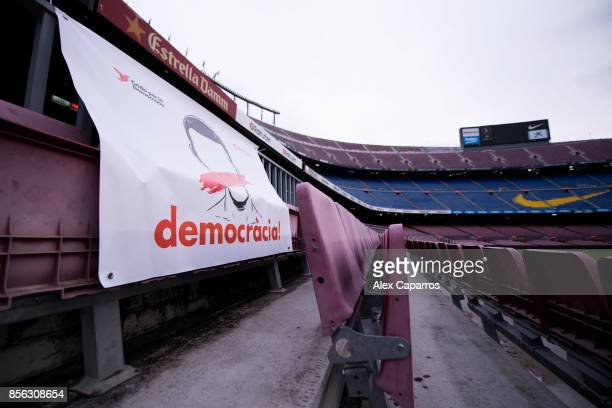 A banner with the word 'Democracia' Catalan for 'Democracy' is seen in the stands of the stadium after the La Liga match between Barcelona and Las...