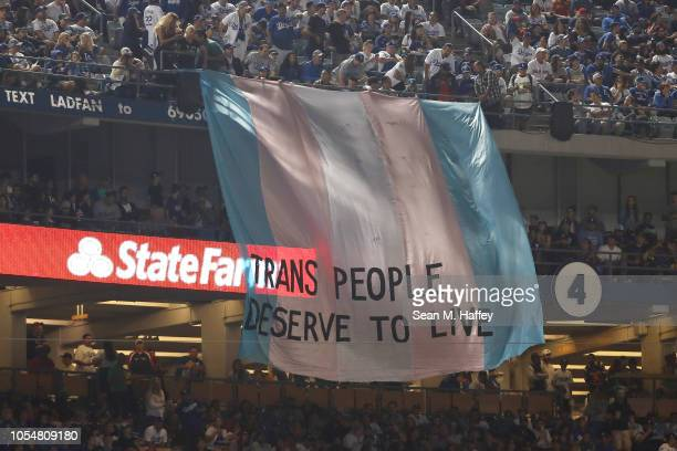 A banner with the words Trans People Deserve to Live is displayed during Game Five of the 2018 World Series between the Los Angeles Dodgers and the...