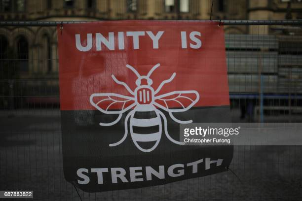 A banner with the Worker Bee the symbol of the City of Manchester adorns a fence in Albert Square on May 24 2017 in Manchester England An explosion...