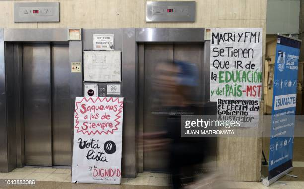 Banners against the Argentine President Mauricio Macri and International Monetary Found are seen at the Medicine Faculty headquarters of the...