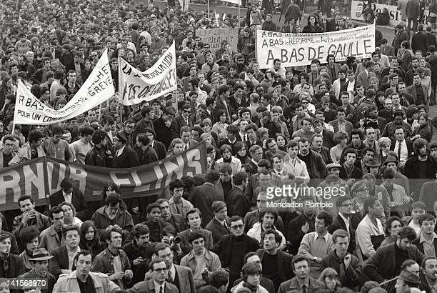 Banners against the President of the French Republic Charles de Gaulle in a demonstration of young students and workers who do not want to interrupt...