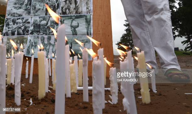 TOPSHOT Banners and candles are displayed on May 30 2018 at the Biafra district in Abidjan during a ceremony commemorating the Biafran War from 1967...