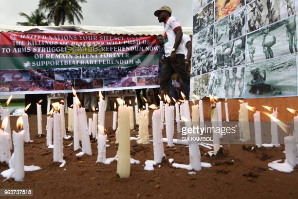 Banners and candles are displayed on May 30 2018 at the Biafra district in Abidjan during a ceremony commemorating the Biafran War from 1967 to 1970