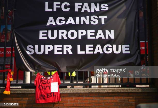 Banners and football scarves are tied to the fences around Anfield Stadium, the home of Liverpool Football Club, in protest at the club's intentions...