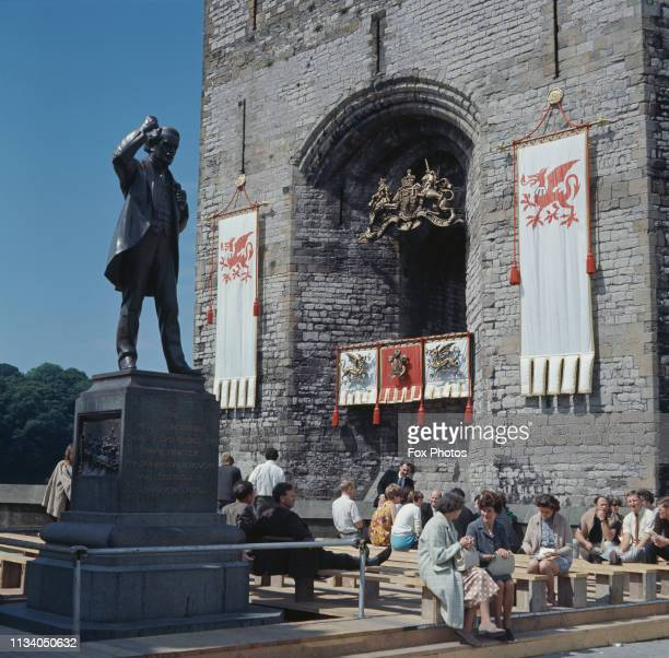 Banners and standards of the Prince of Wales hung outside Queen Eleanor's Gate at Caernarfon Castle ready for the investiture of Prince Charles as...