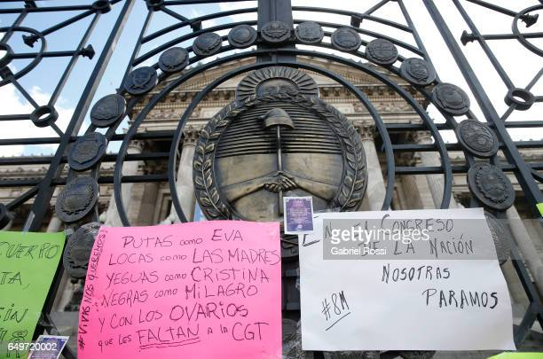 Banners are displayd on the gates of Buenos Aires Congress during a protest commemorating the International Women's Day at Congress on March 08 2017...