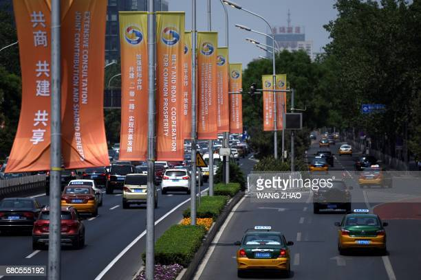 Banners are displayed along a street ahead of Belt and Road Forum for International Cooperation in Beijing on May 9 2017 / AFP PHOTO / WANG ZHAO