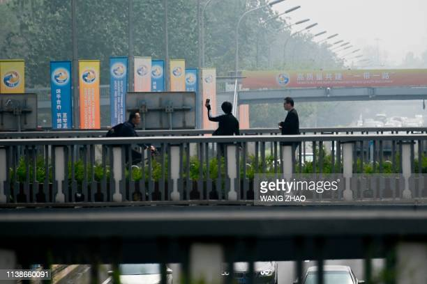 Banners are displayed along a street ahead of the Belt and Road Forum in Beijing on April 22 2019