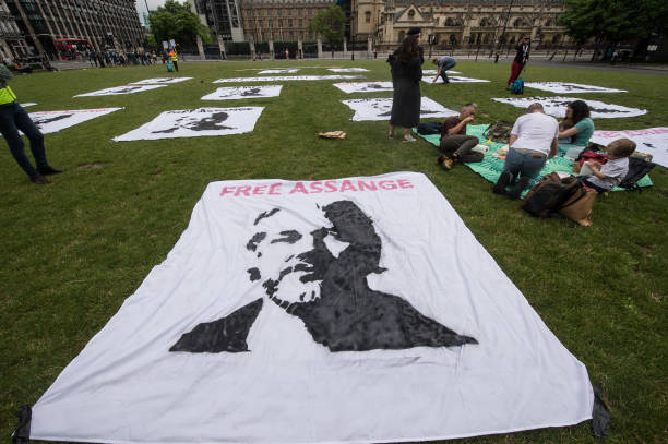 Banners are laid out as a protest picnic demanding the release of Julian Assange is held on his 50th birthday at Parliament Square on July 3, 2021 in...