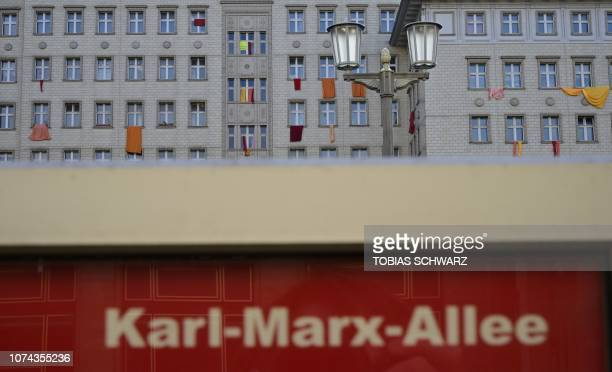 TOPSHOT Banners are placed in windows of a socalled Stalinbau building in Berlin's KarlMarx Allee on December 18 2018 Tenants are protesting against...