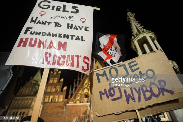 Banners are seen during a protest against proposals to tightening of abortion laws at the Main Square in Wroclaw Women associations called a national...