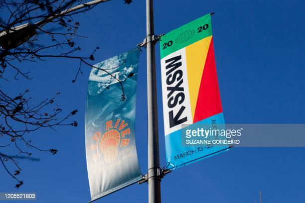 SXSW 2020 banners are seen in the Red River Cultural District on March 6 2020 in Austin Texas The South by Southwest festival in Texas has been...