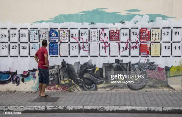 Banners are seen on the wall ahead of the Parliamentary elections which will be held at 6 October in Tunis, Tunisia on September 20, 2019.