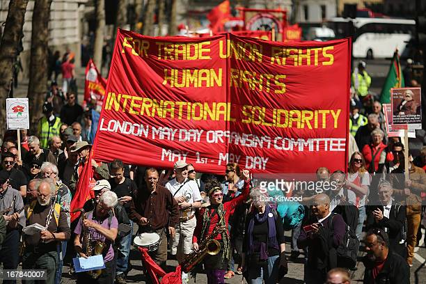 Banners are waved during the annual May Day march on May 01 2013 in London England Students trade unionists pensioners and activists staged a march...