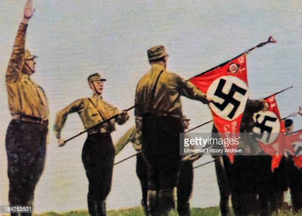 Banners carried by Nazi party members at a rally germany 1932