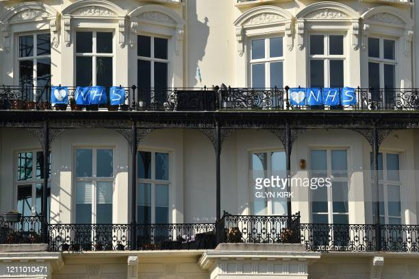 Banners celebrating the NHS are seen on the beachfront in Hove on the south coast of England on April 25 during the national lockdown due to the...
