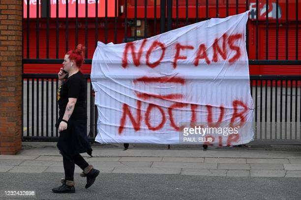 Banners critical of the European Super League project hang from the railings of Anfield stadium, home of English Premier League football club...