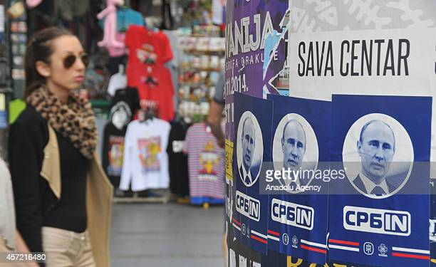 Banners depicting Russian President Vladimir Putin for the upcoming visit of him to Serbia on October 16 are hanged on the streets of Belgrade on...