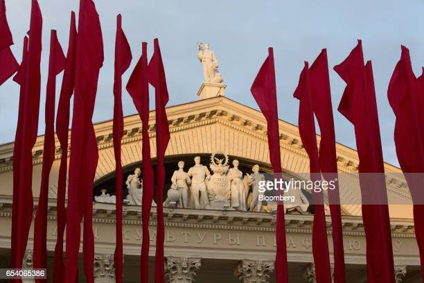Banners fly beside the carved facade of the Minsk Trade Union Palace of Culture building in Minsk Belarus on Wednesday March 15 2017 Belarusian...
