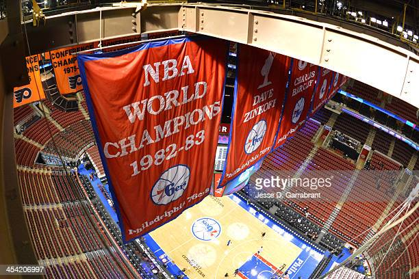 Banners hang atop of the arena before the game between the Philadelphia 76ers and the Denver Nuggets at the Wells Fargo Center on December 7, 2013 in...