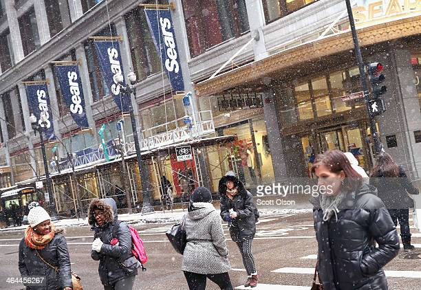Banners hang from Sears' flagship store in the Loop on January 22 2014 in Chicago Illinois Sears has announced that it plans to close the moneylosing...