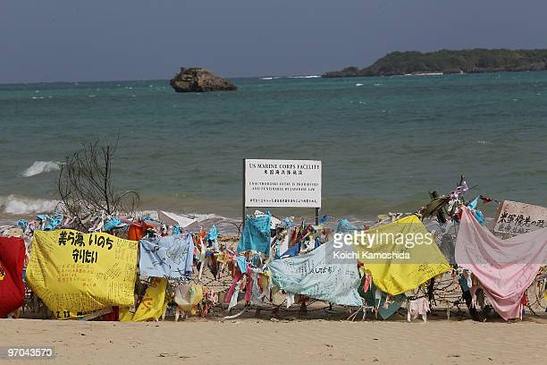 Banners hang on barbed wire on the coast of Henoko, near the US military base Camp Schwab and one of the possible relocation site of U.S. Air Base in...