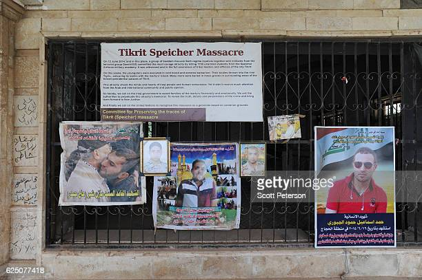 Banners mark the memorial to the Islamic State massacre of 1700 Shiite Air Force cadets from Camp Speicher beneath a bridge where victims were shot...