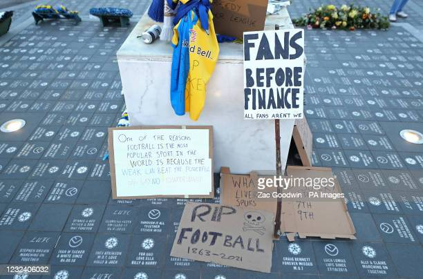 Banners next to the statue of former Leeds United player Billy Bremner, as fans protest against Liverpool's decision to be included amongst the clubs...