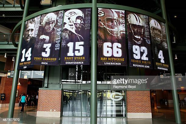 Banners of former Green Bay Packers football players Don Hhutson Tony Canadeo Bart Starr Ray Nitschke Reggie White and Brett Favre hangs inside the...