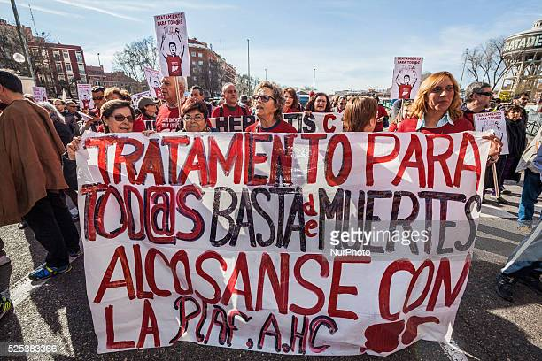 Banners of protesters during the demonstration on March 1 2015 in Madrid for support of hepatitis C patients claiming for the last effective...
