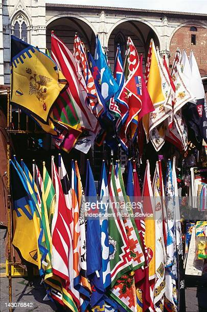 Banners of the Contrade sold before the beginning of the Palio di Siena Italy