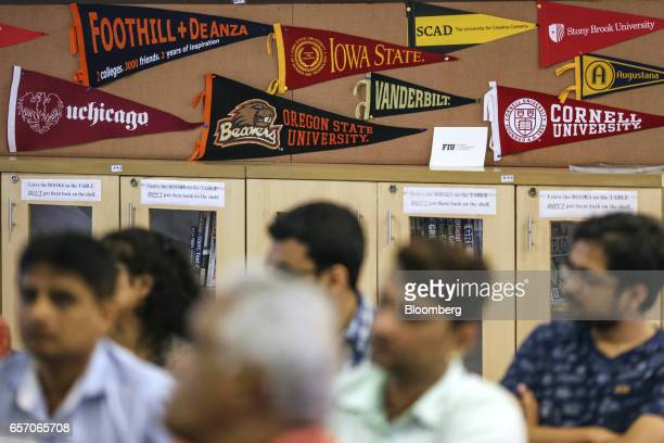 Banners of US universities are displayed in a classroom as participants attend a counseling session given by the University of Southern California at...