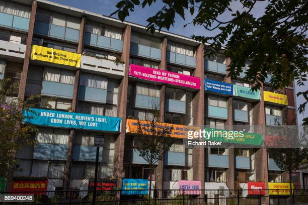 Banners on the balconies of homes in Bowater House on the Golden Lane Estate to protest about the 10storey luxury apartment development called The...