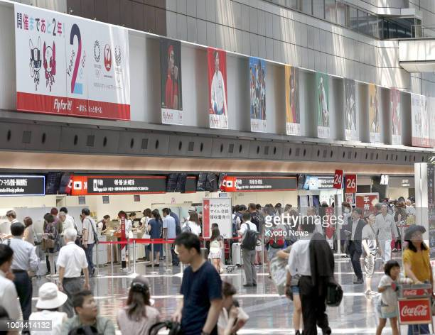 Banners promoting the 2020 Tokyo Olympics and Paralympics are seen at Tokyo's Haneda airport on July 24 exactly two years before the Summer Games...