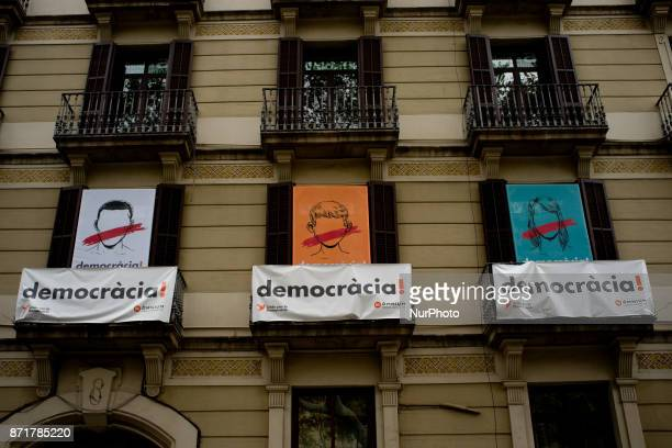 Banners reading democracy in balconies of Barcelona Spain on 8 November 2017 Catalonian territory went on general strike against the imprisonment of...