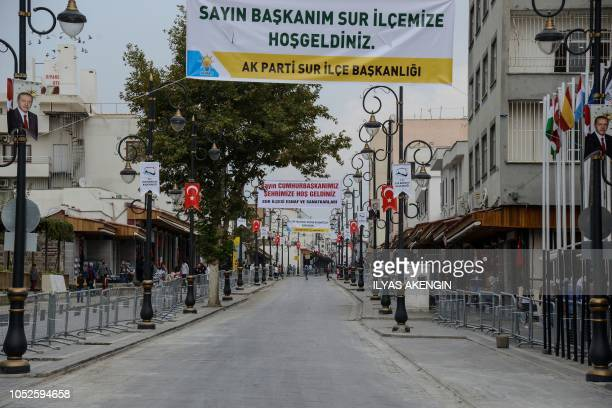 """Banners reading """"Welcome to our President at Sur"""" hang above empty streets at historical Sur district in Diyarbakir on October 20 before Turkish..."""