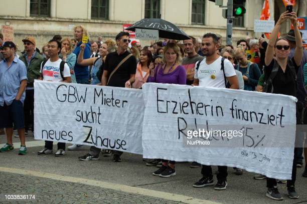 Banners referring to the more than 30.000 state held appartments sold by Markus Soeder. Among the police more than 7000 people protested under the...