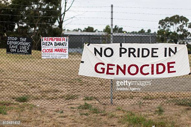 Banners relating to the closure of the Manus Island detention centre Reza Barati and Aboriginal Genocide hung at the gates of a refugee detention...