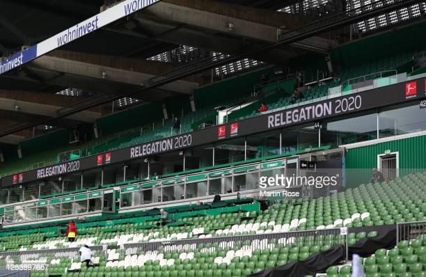Banners show the sign relegation 2020 in the Weser Stadium prior to the Bundesliga playoff first leg match between Werder Bremen and 1. FC Heidenheim...