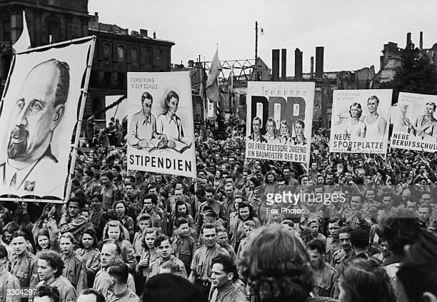 Banners showing Communist achievements being carried by the young marchers during a Youth Rally demonstration in East Berlin